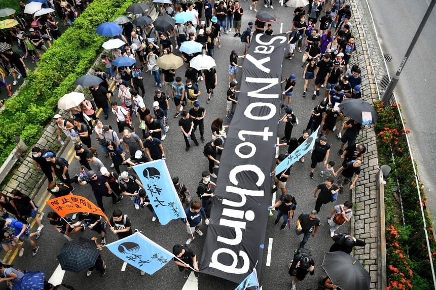 Protesters marching past the Po Lam Estate during the Tseung Kwan O protest on Aug 4, 2019.
