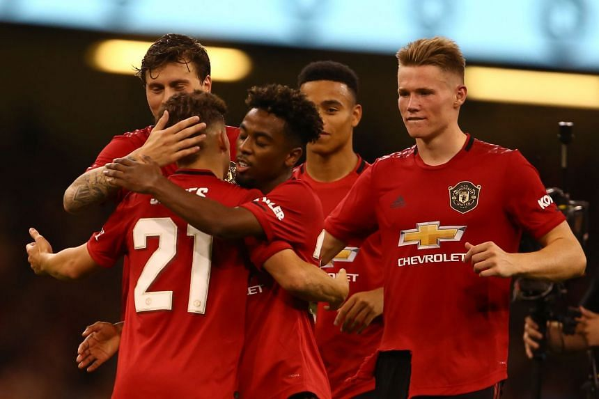 Daniel James (left) celebrates with team mates after scoring the winning penalty.