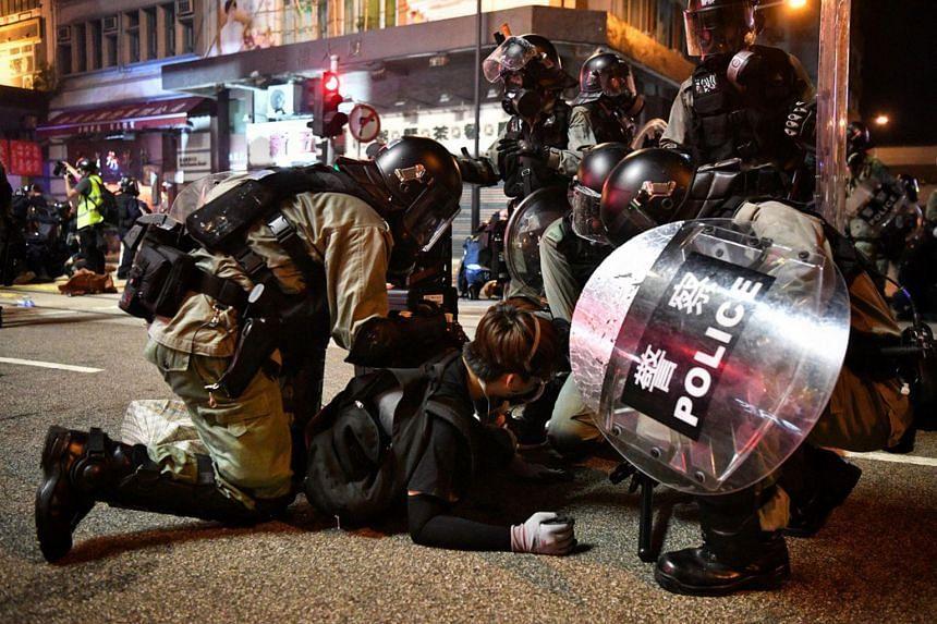Hong Kong police arresting protesters near Morrison Street, Hong Kong, on July 28, 2019.