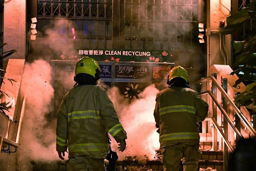 Protesters outside the Tsim Sha Tsui Police Station started a blaze in front of one of the building's entrances.