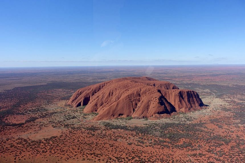 There are regular stops on the Segway tour of Uluru (left) for the guide to explain the features in the area and a helicopter ride offers sweeping views of the rock (below).