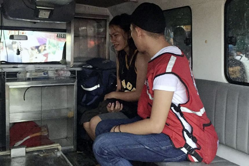 A rescue worker talks to a crying survivor after a ferry boat capsized due to bad weather in the waters between Guimaras and Iloilo provinces.