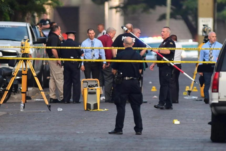 Police officers working at the crime scene of a mass shooting in the Oregon district of Dayton, Ohio, on Aug 4, 2019.