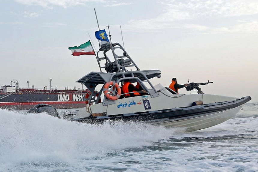 Revolutionary Guard jet boat sailing around a seized tanker in Bandar Abbas, Iran, on July 21, 2019. Iran has reportedly seized another foreign tanker in the Gulf on Aug 4, 2019.