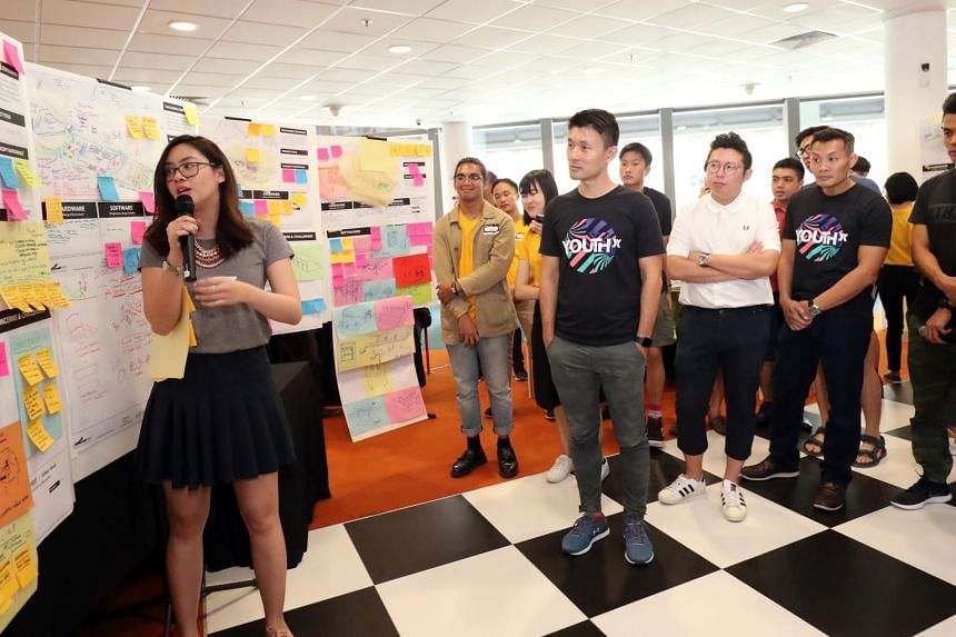 Senior Parliamentary Secretary for Culture, Community and Youth and Transport Baey Yam Keng (centre) and other participants taking part in a discussion at the Somerset Belt Urban Youth Catalyst - Urban Hack, at the Sports Hub Library on Aug 4, 2019.