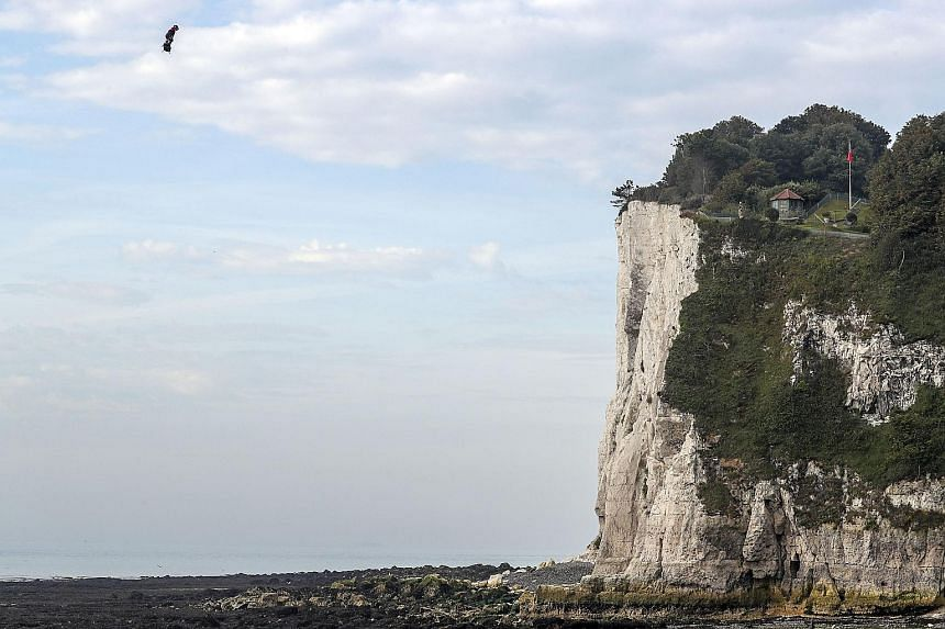 French inventor Franky Zapata approaching St Margaret's Bay in Dover yesterday after crossing the English Channel on a hoverboard. A previous attempt last month ended with him falling into the sea, but this time around he zoomed over the Strait of Do