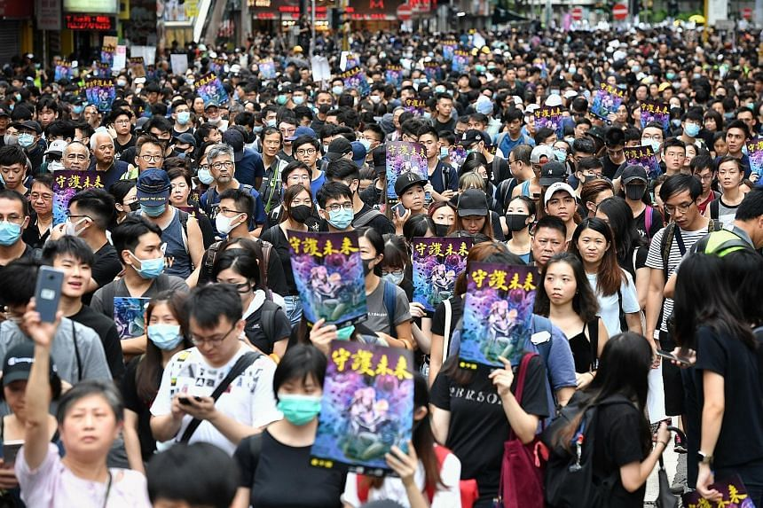 Protesters marching from Mong Kok on Saturday. The protest movement that started as opposition to an extradition Bill to allow Hong Kong to send criminal suspects to China for trial has turned into a popular revolt.