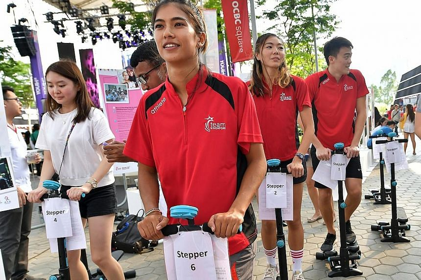Singapore athletes (from left) Sasha Christian (wakeboard), Michelle Sng (high jump) and Christopher Cheong (swimming) all lost loved ones to cancer. Through the stair-climbing activity yesterday, they were helping to raise awareness of adolescents a