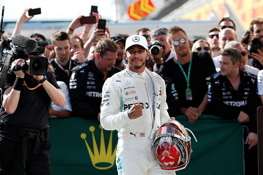 Mercedes' Lewis Hamilton celebrates winning the Hungarian Grand Prix with his team. With Mercedes teammate Valtteri Bottas managing only eighth place, his lead has grown to a massive 62 points.