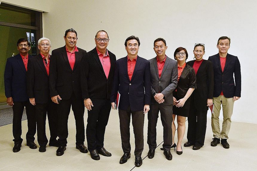 Singapore Athletics president Tang Weng Fei (centre) and his team members (from left) S. Govindaraju, Eric Song, Syed Malik Aljunied, Ang Peng Siong, Poh Seng Song, Sheena Hu, Belinda Foo and Kenny Lim before their election last October. It is not ra