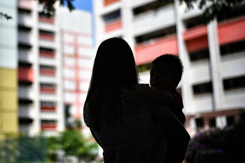 Last year, the authorities disclosed that the median monthly income of a single unwed parent under the age of 35 was $600 in 2017. ST PHOTO: ARIFFIN JAMAR Single mother Khairianti Putri and her daughter Luna, who is two years old. Ms Putri, now 22, s