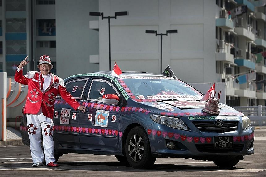Gojek driver Henry Ho, who has been decorating his car and customising outfits for National Day for more than 10 years, made a birthday cake model to install at the front of his car this year.