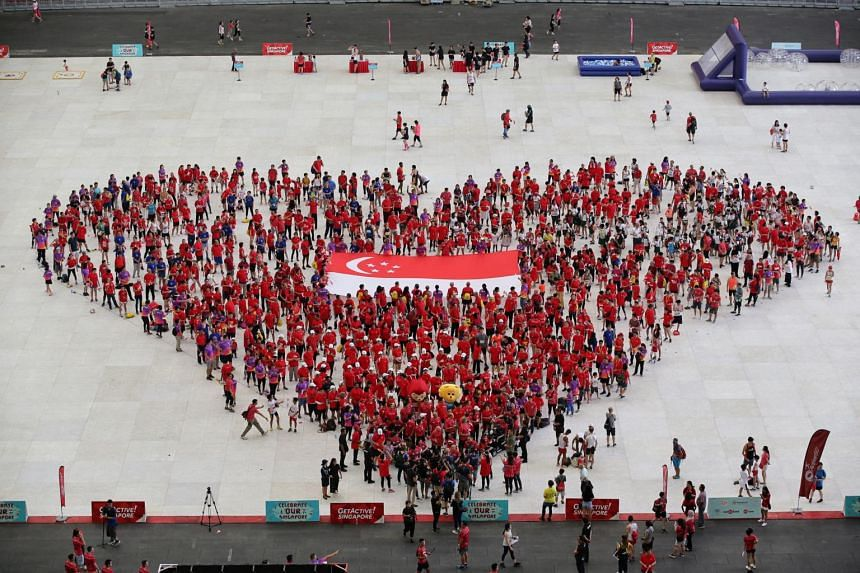 President Halimah Yacob and Minister for Culture, Community and Youth Grace Fu also joined volunteers in a heart formation, which symbolised this year's focus on care for others and community-mindedness.