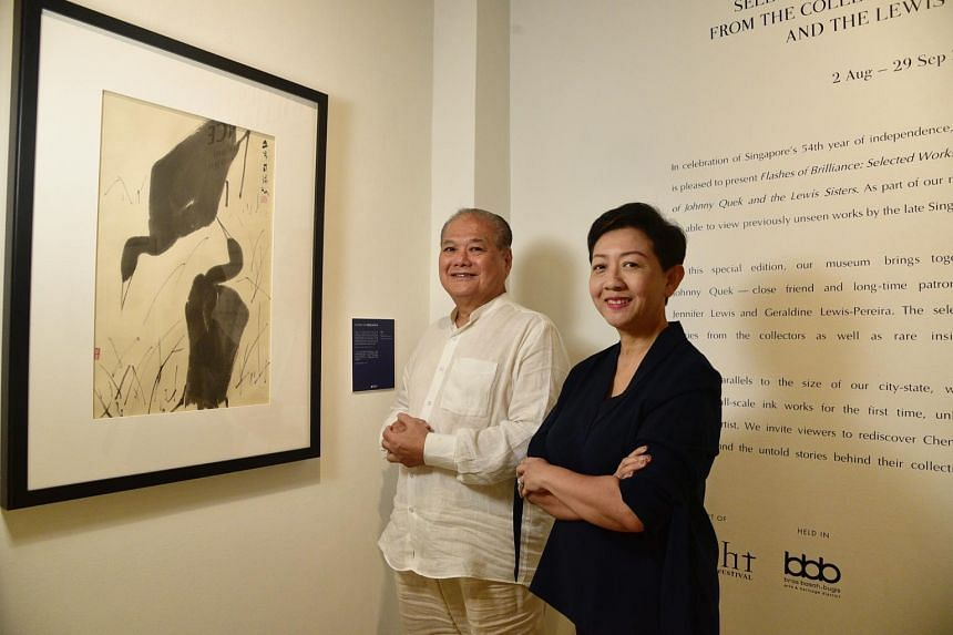 Mr Johnny Quek and Ms Jennifer Lewis with one of Chen Wen Hsi's paintings.