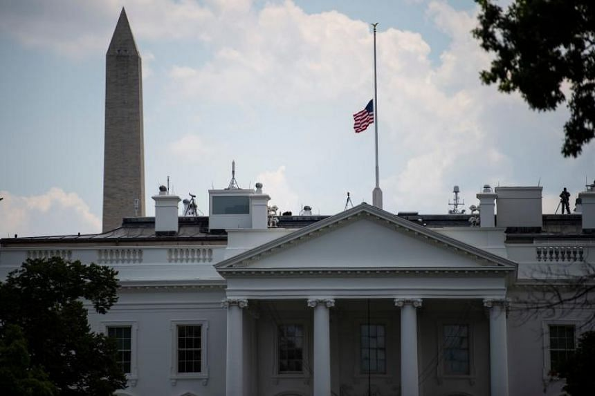 The US national flag flies at half-mast following the recent mass shooting in El Paso and Dayton on Aug 4, 2019 in Washington,DC.
