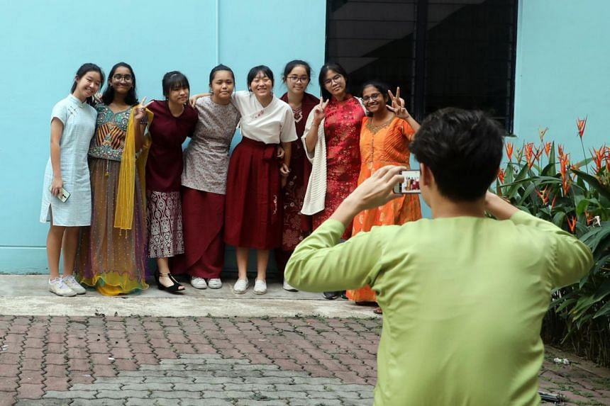 Students dressed in various ethnic costumes to commemorate Racial Harmony Day on July 19, 2019.