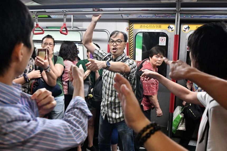 Protesters holding up trains and disrupting morning train services at Fortress Hill MTR station in Hong Kong, on Aug 5, 2019.