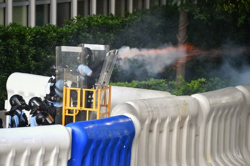 Hong Kong police fire tear gas at protesters outside the Legislative Council complex in Hong Kong on Aug 5, 2019.