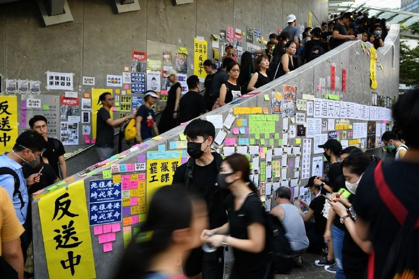 """Protesters create a new """"Lennon Wall"""" outside the Legislative Council complex in Hong Kong on Aug 5, 2019."""
