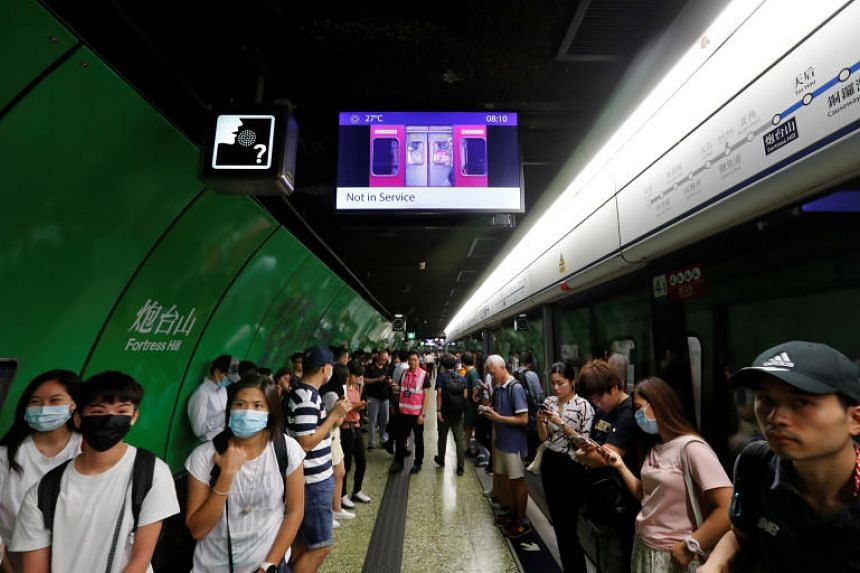 Passengers wait for the resumption of Mass Transit Railway (MTR) services during a disruption by protesters at Fortress Hill station in Hong Kong on Aug 5, 2019.