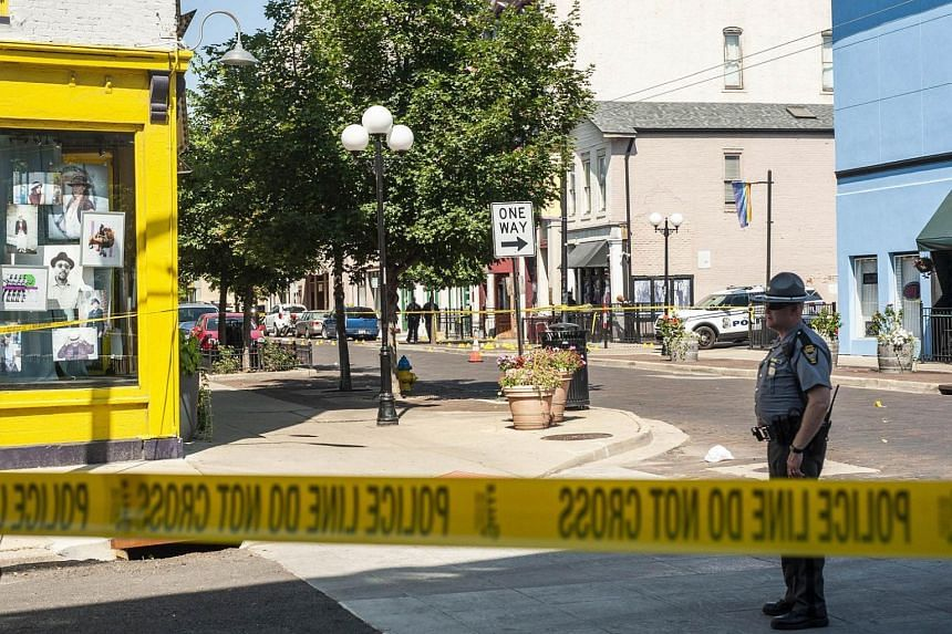 Law enforcement officials investigate the scene where a gunman opened fire on a crowd of people over night on Fifth Avenue in the Oregon District, on Aug 4, 2019.