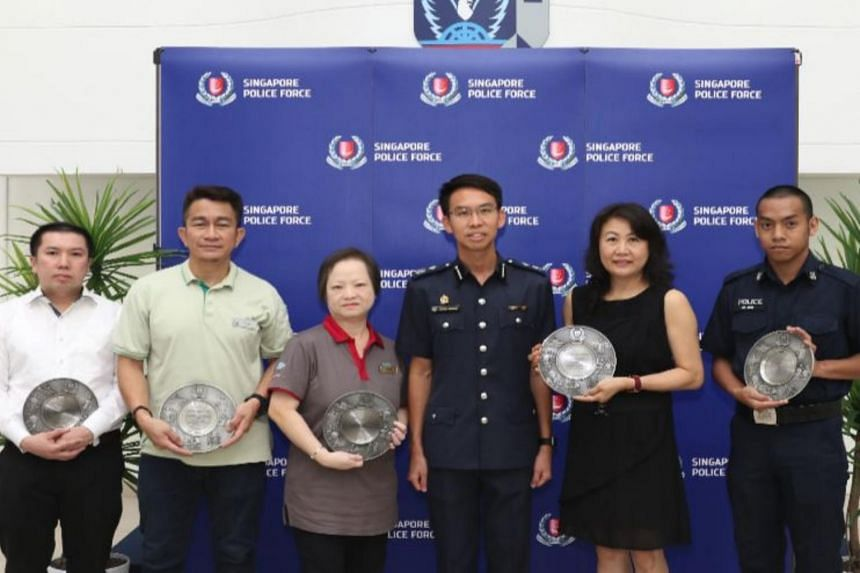 Assistant Commissioner of Police Zhang Weihan with the five recipients of the Public Spiritedness Award.