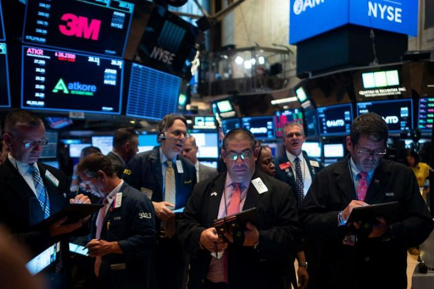 Traders work after the opening bell at the New York Stock Exchange on Aug 5, 2019.
