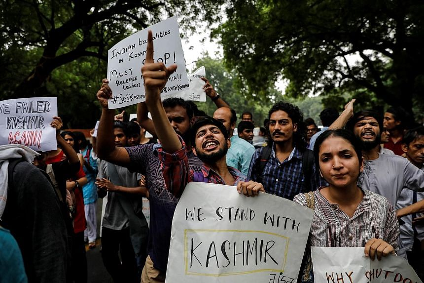 People protesting in New Delhi yesterday after the Indian government scrapped the special status for Kashmir.