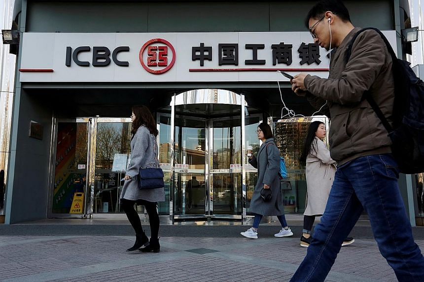Analysts predict that more of China's roughly 4,000 small lenders will run into trouble and that bigger banks, such as Industrial and Commercial Bank of China (above), will be asked to shore them up. While regulators could allow distressed lenders to