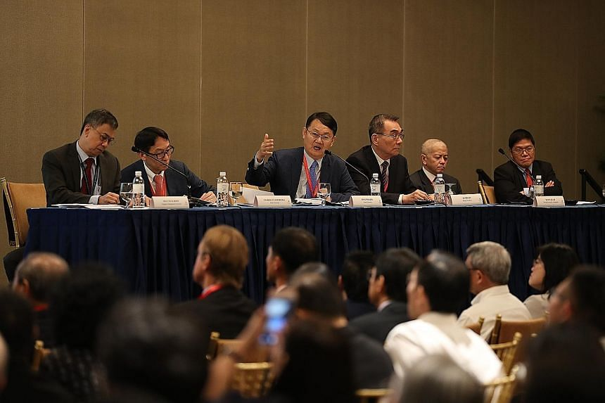 From left: Panellists Hoon Hian Teck from Singapore Management University, Charles Horioka from Kobe University, Lee Jong-Wha from Korea University, Justin Lin from Peking University, Danny Quah from the Lee Kuan Yew School of Public Policy at the Na