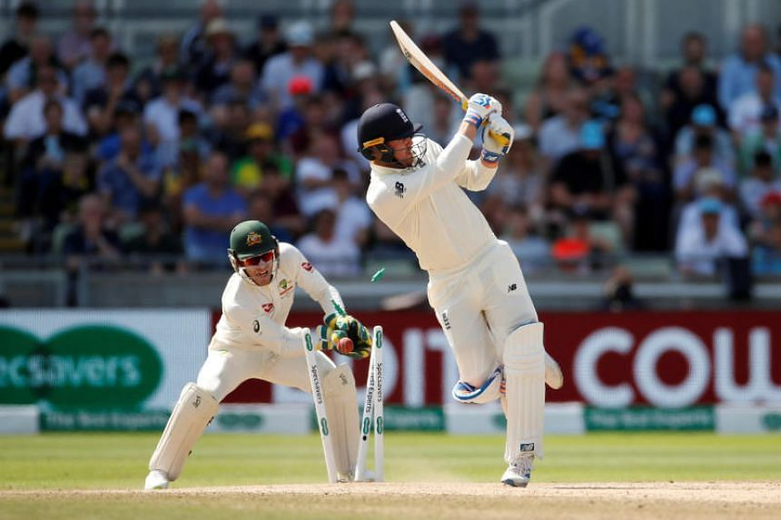 England's Jason Roy is bowled out by Australia's Nathan Lyon.
