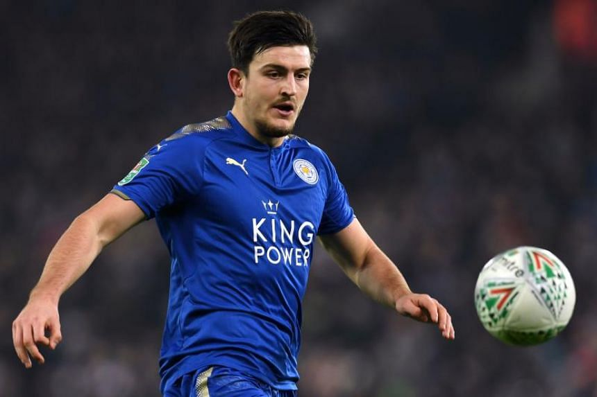 In this file photo from 2017, Leicester City's English defender Harry Maguire eyes the ball during the English League Cup quarter-final football match in Leicester. Maguire signed a six-year contract with the option to extend for a further year.