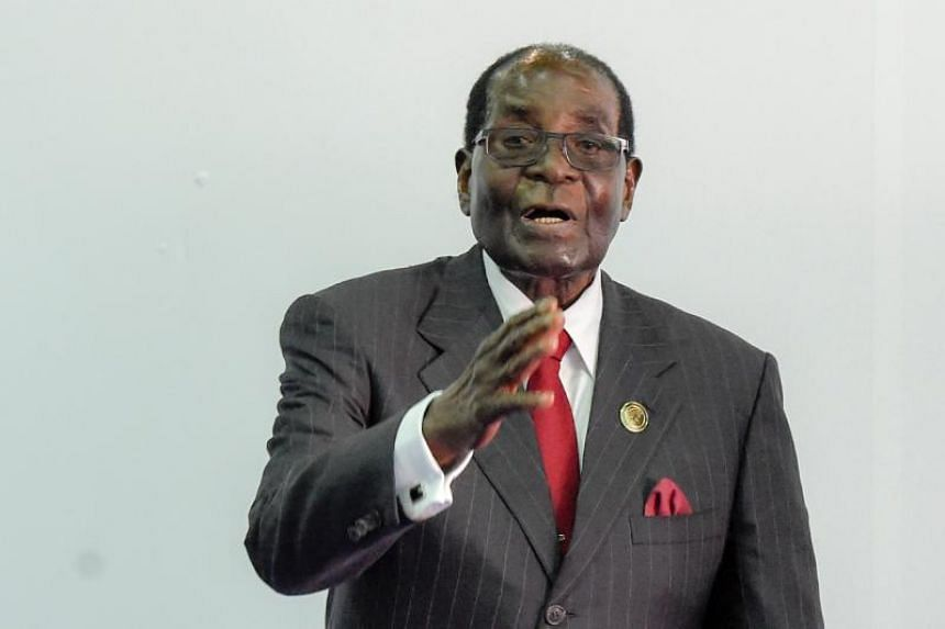 In this file photo from 2016, then Zimbabwean President Robert Mugabe is seen at the Non-Aligned Movement summit in Porlamar, Margarita Island, Venezuela. 95-year-old Mugabe has been receiving medical care for an undisclosed ailment, and is respondin
