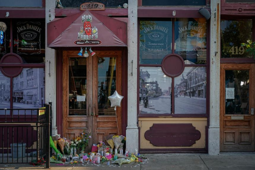 A memorial fills the doorway in front of Ned Peppers Bar, the scene of Sunday night's mass shooting in Dayton, Ohio, on Aug 5, 2019.