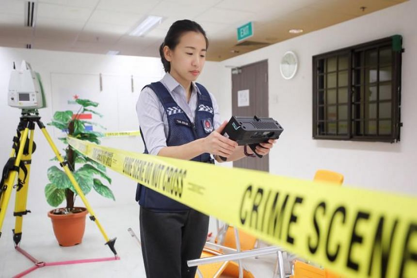 Ms Tan Joe-Lin demonstrating the use of the 3D Handheld Scanner, which is capable of taking real-time scans of various types of confined crime scenes and hard-to-reach areas.