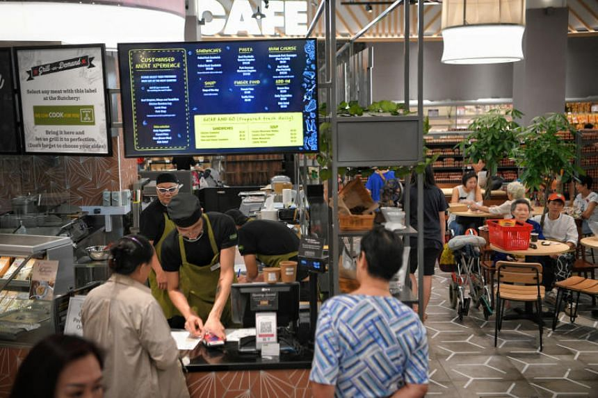 VivoCity's new FairPrice Xtra outlet offers food preparation services where vegetables, meat and seafood can be processed and prepared.