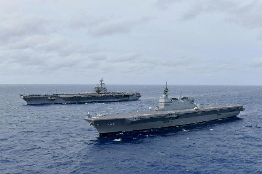 The US Navy flew a small group of Philippine generals, officials and journalists to the USS Ronald Reagan, where fighter jets landed and took off by catapult with thunderous blasts.