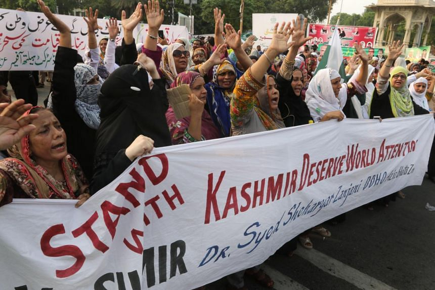People shout slogans during a protest after the Indian government removed the special constitutional semi-autonomous status granted to the region of Kashmir, which both India and Pakistan claim, in Lahore, Pakistan, on Aug 5, 2019.