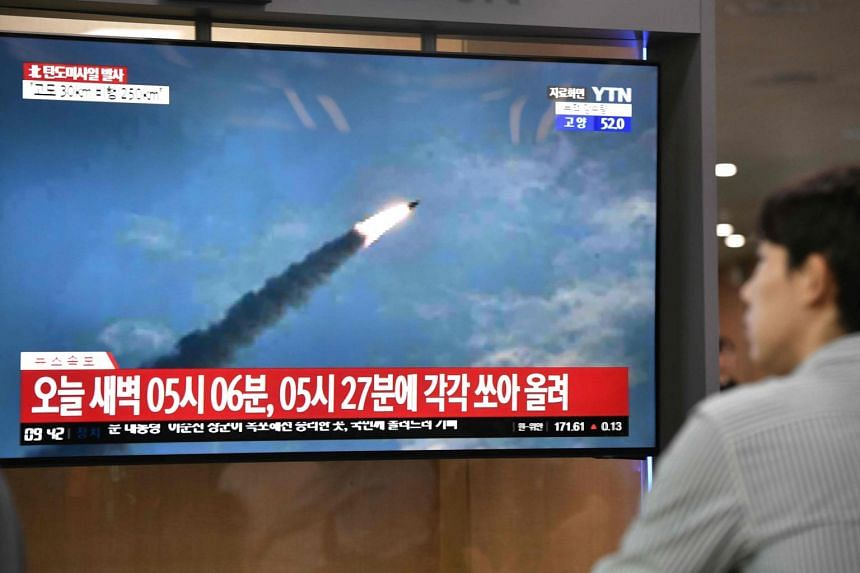 In this file photo taken on July 31, a man watches a file footage of a North Korean missile launch, at a railway station in Seoul.