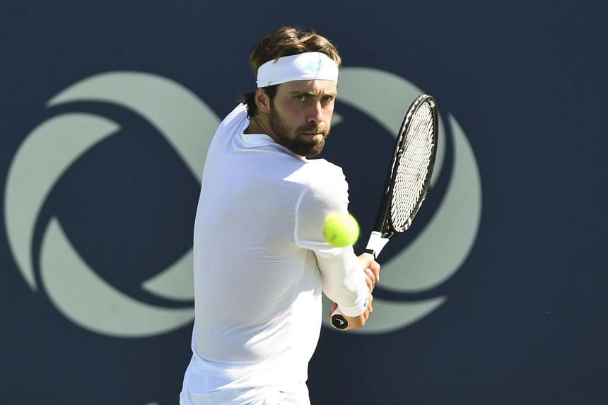 Nikoloz Basilashvili of Georgia (above) hits a return ball against Dusan Lajovic of Serbia during day 4 of the Rogers Cup on Aug 5, 2019.