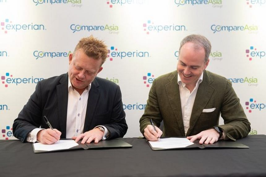 Mr Ben Elliott (left), chief executive officer of Experian Asia Pacific, and Mr Sam Allen, CEO of CompareAsiaGroup, sealing the partnership deal.