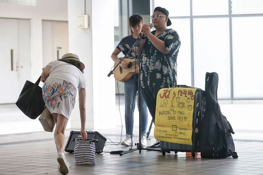 Mr Amirul Jamil and Ms Jonquil Woon busking in Tampines last year. There are now about 300 endorsed buskers under a scheme for the community of such performers in Singapore, more than double the number in 2008. Half of them are below the age of 35.