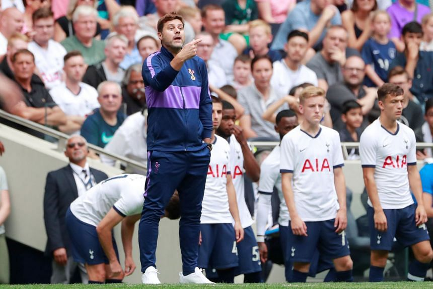 Mauricio Pochettino will pit his wits against promoted side Aston Villa, who have outspent last season's Champions League finalists. Arsenal's Unai Emery (above) will hope to improve in his second season in charge of the Europa League finalists. PHOT