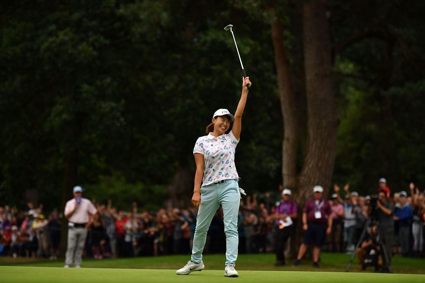 Japan's Hinako Shibuno celebrates after holing a long birdie putt on the 18th green to win the Women's British Open at the Woburn Golf Club on Sunday. It was the 20-year-old's first Major win, on her British Open debut.