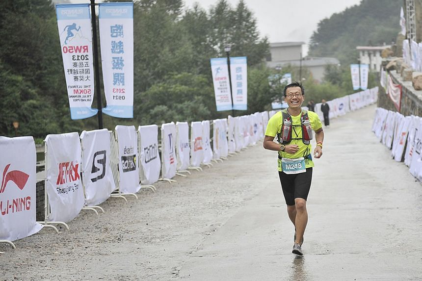 Dr Tan Eng Han taking part in a race near Beijing in 2015. On Aug 9, he will run 200km solo in Shanghai to raise funds for a charity and celebrate Singapore's bicentennial.