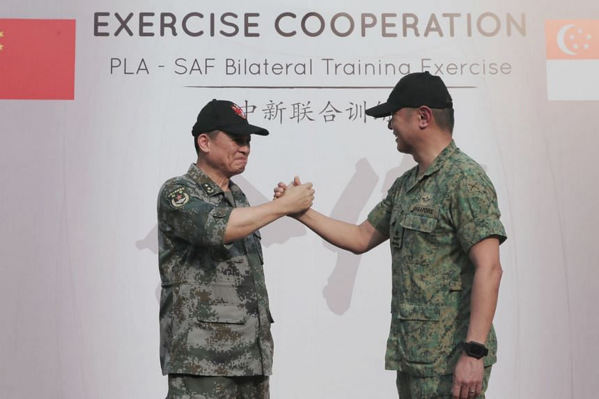 Lieutenant-General Zhang Jian (left), Commander of the Southern Theatre Command Army of the People's Liberation Army, with Brigadier-General Kenneth Liow, the Singapore Armed Forces' Chief of Staff for General Staff.