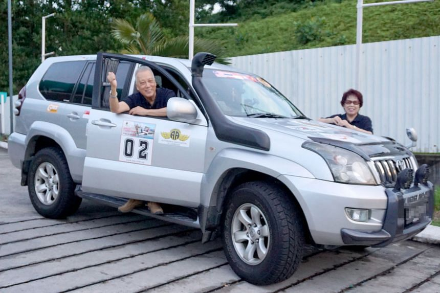 A 2016 file photo of Mr See Lew Hang and his wife Fong Yim Peng on an auto-venture trip to Cambodia. They will be flagged off on their London to Singapore trip with other participants on Saturday.