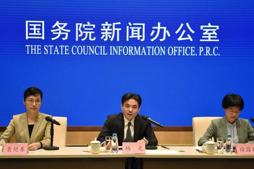 Yang Guang (centre) spokesperson for mainland China's Hong Kong and Macau Affairs Officeof the State Council, speaks concerning the ongoing protests in Hong Kong, as fellow spokesperson Xu Luying (right) and host Xi Yanchun listen at a press conferen