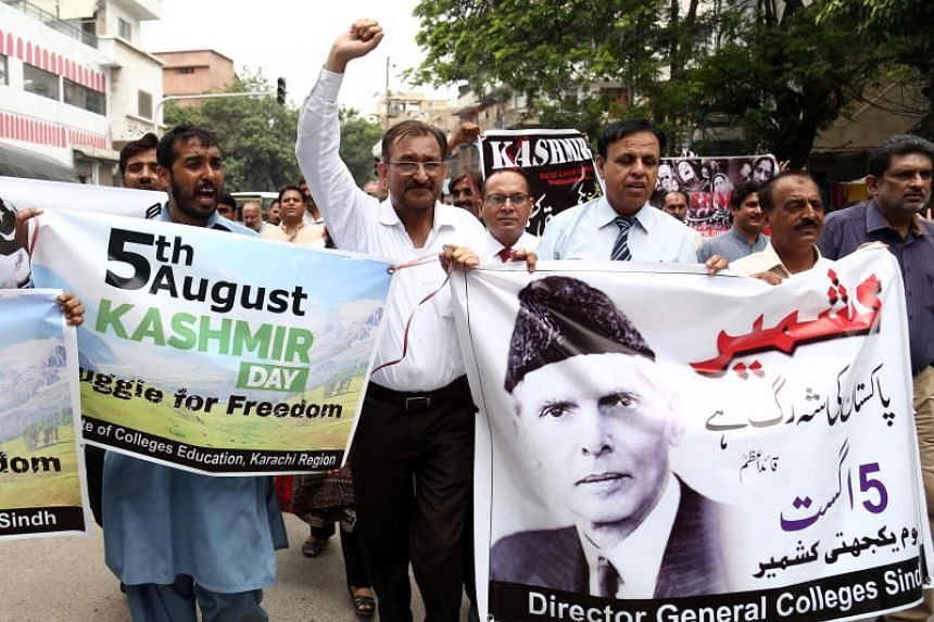 People rally during a protest in Muzaffarabad, the capital of Pakistani-administered Kashmir, on Aug 5, 2019, after the Indian government removed the special constitutional semi-autonomous status granted to the region of Kashmir, which both India and