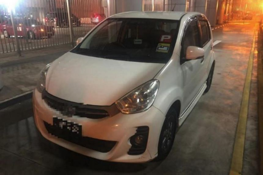 The Malaysian car was departing Singapore at Woodlands Checkpoint on Aug 5. The vehicle could be forfeited if offenders are found guilty of engaging in illegal business of taking prohibited immigrants out of the country.